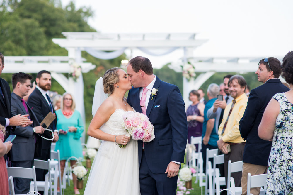 Elegant Navy and Blush Estate Wedding | End of Aisle Wedding Ceremony Kiss