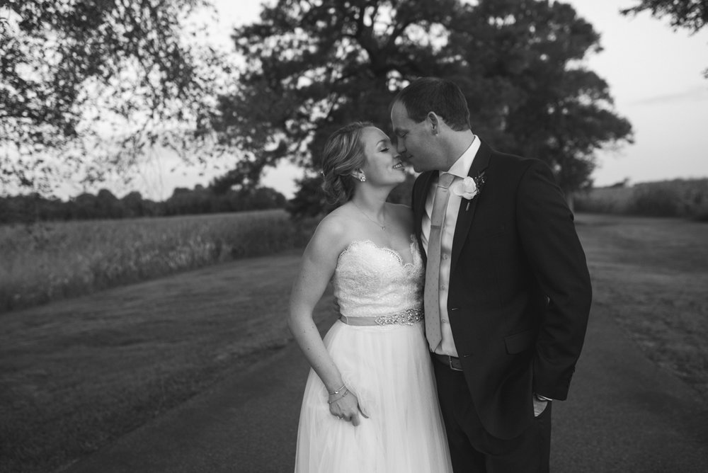 Elegant Navy and Blush Estate Wedding | Black and White Bride and Groom Portraits