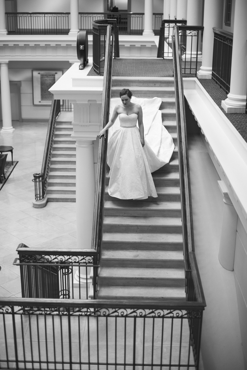 Sparkly Gold and White Fall Wedding | Bride walking down staircase