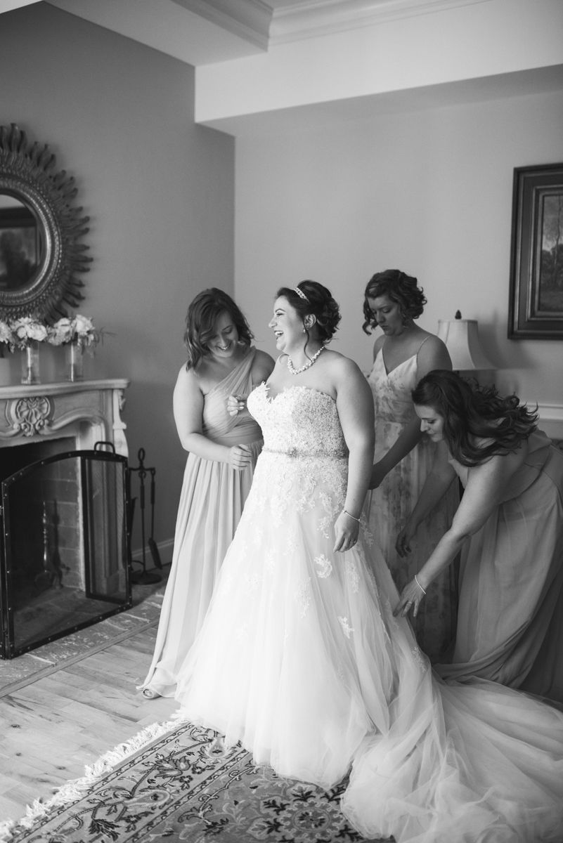 Powder Blue and Burgundy Fall Winery Wedding | Bride getting dressed
