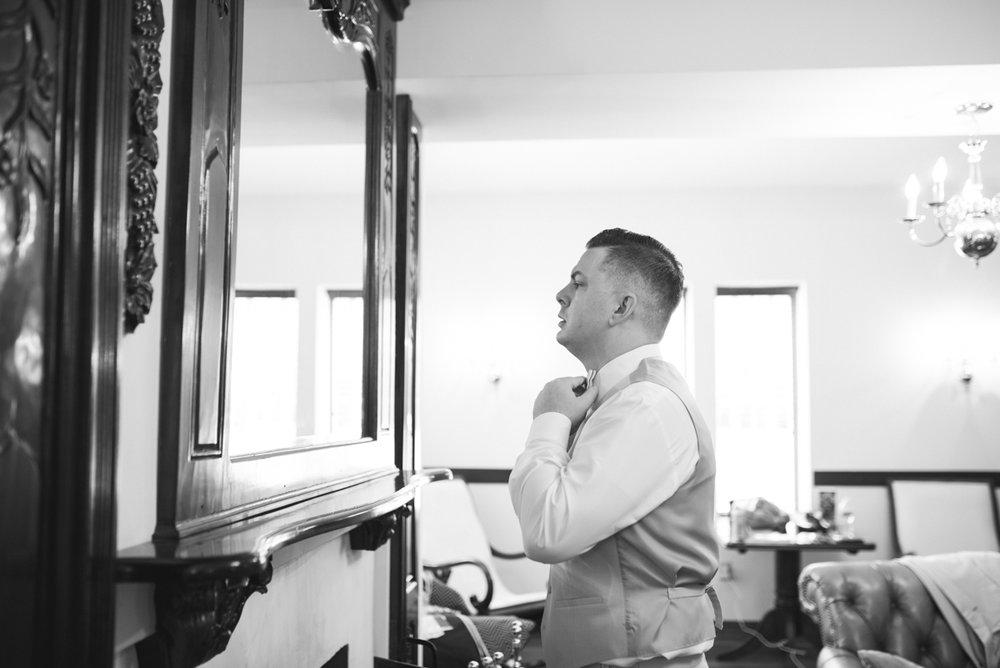 Powder Blue and Burgundy Fall Winery Wedding | Groom getting ready