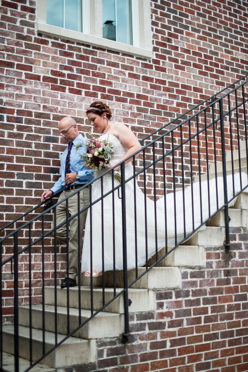 Powder Blue and Burgundy Fall Winery Wedding | Bride coming down the staircase