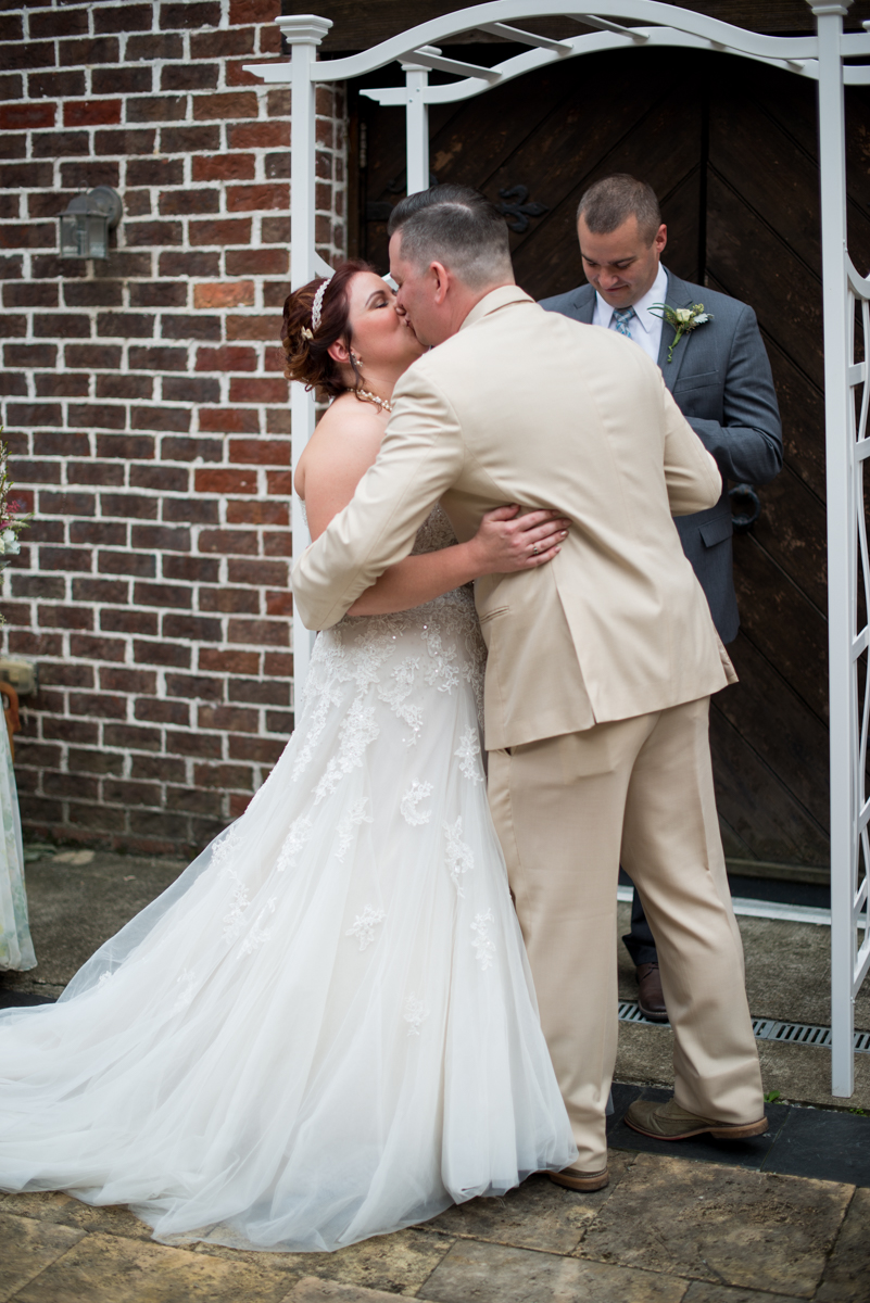 Powder Blue and Burgundy Fall Winery Wedding | Bride and groom first kiss