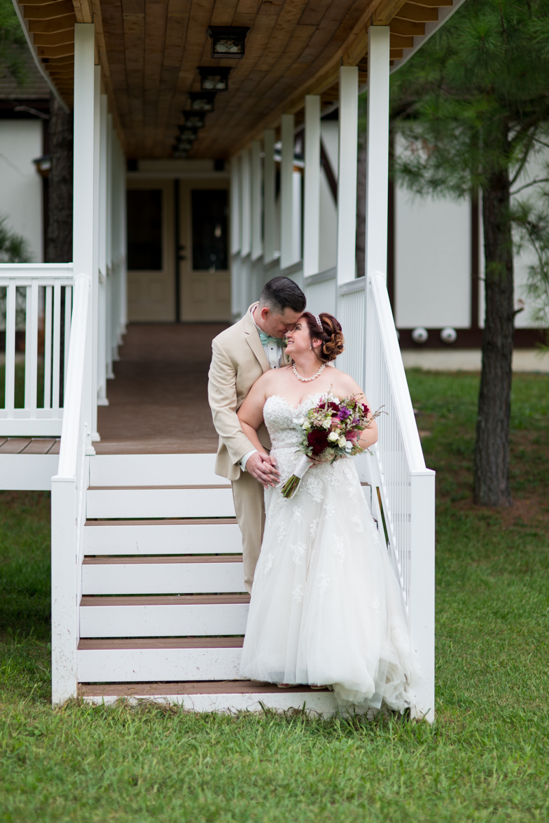 Powder Blue and Burgundy Fall Winery Wedding | Bride and groom portraits