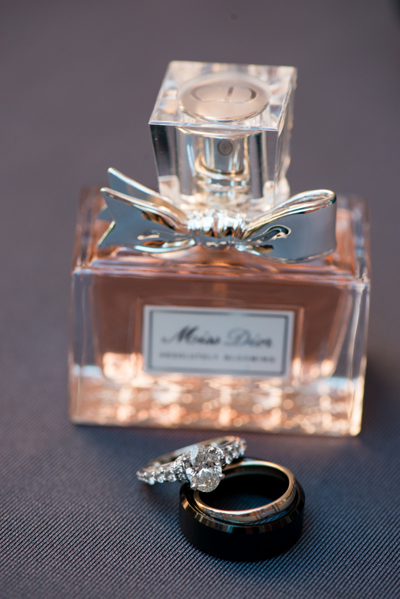 Downtown Classic Emerald and Black Tie Wedding | Ring Shot with Miss Dior Perfume