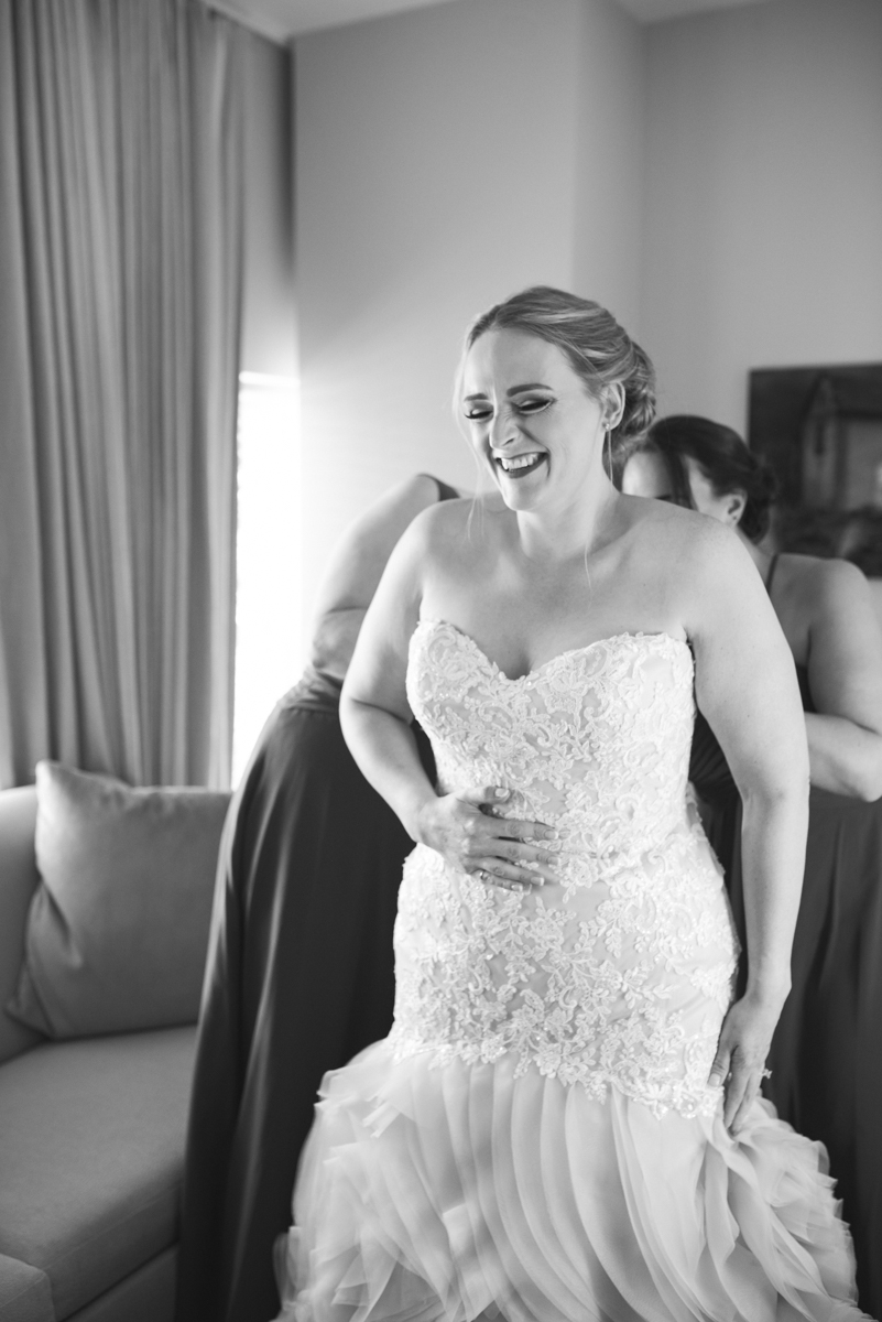 Downtown Classic Emerald and Black Tie Wedding | Bride getting dressed