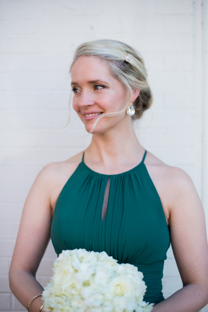 Downtown Classic Emerald and Black Tie Wedding | Bridesmaid in emerald green