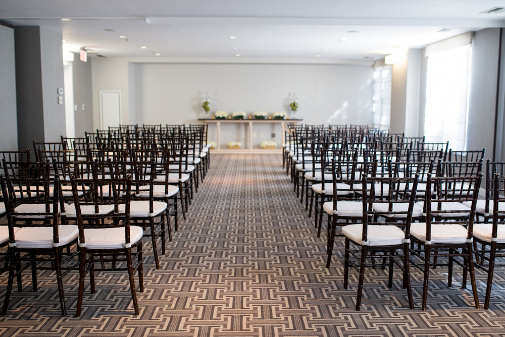 Downtown Classic Emerald and Black Tie Wedding | Indoor wedding ceremony with Chiavari chairs