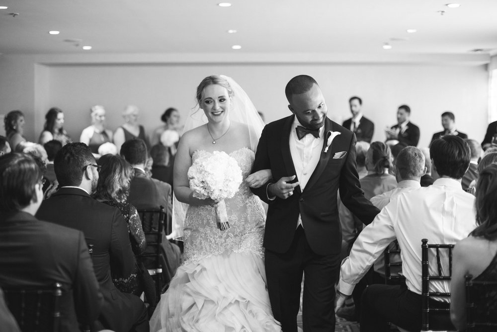 Downtown Classic Emerald and Black Tie Wedding | Bride and groom recessional