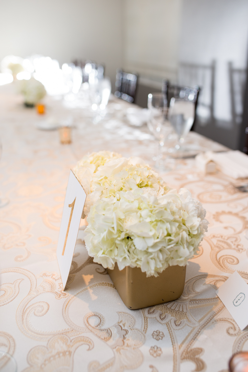 Downtown Classic Emerald and Black Tie Wedding | White and Gold Centerpiece