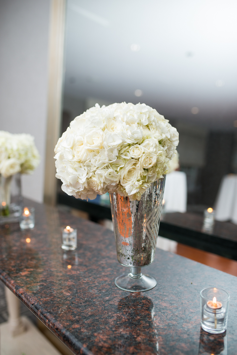 Downtown Classic Emerald and Black Tie Wedding | White Rose Centerpiece