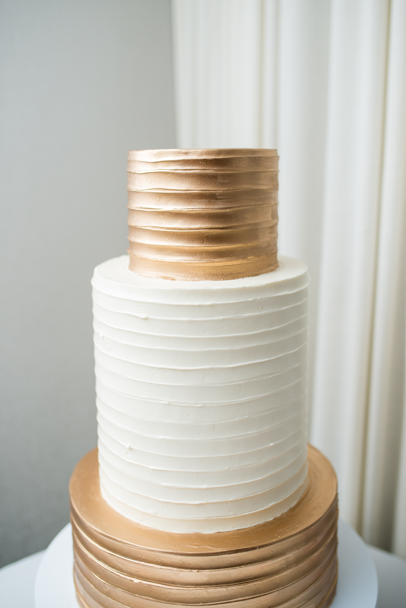 Downtown Classic Emerald and Black Tie Wedding | Metallic Gold and White Wedding Cake