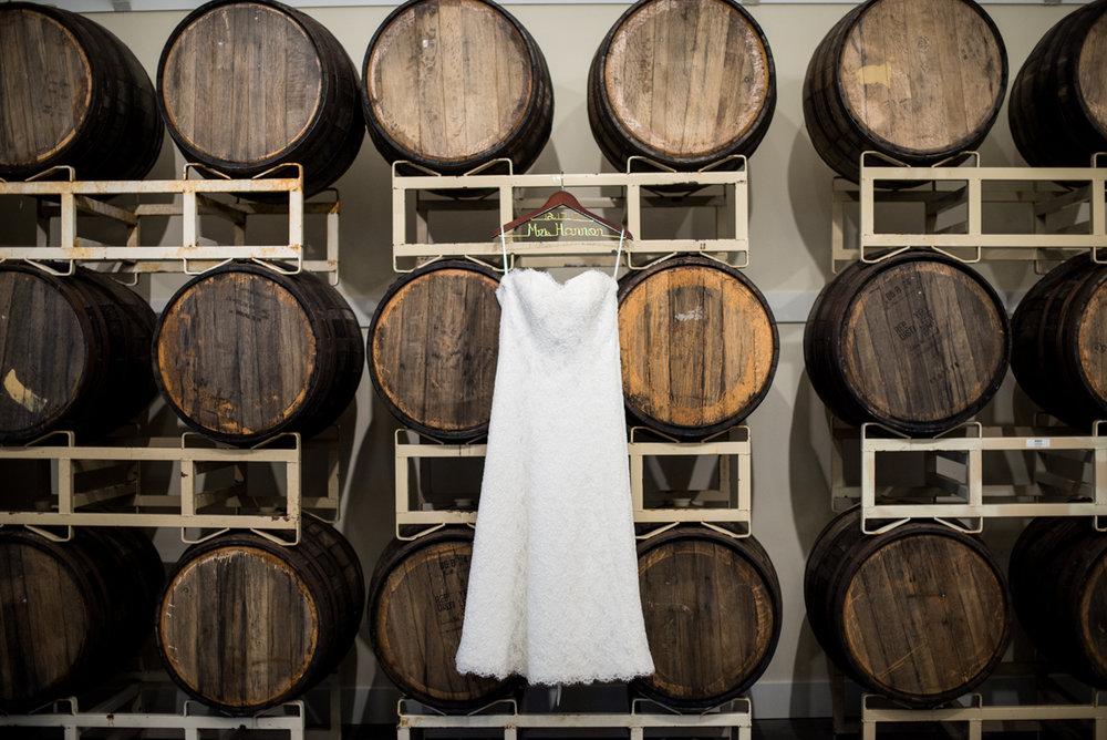 Gold and Burgundy Winter Winery Wedding | Wedding Dress in Barrel Room