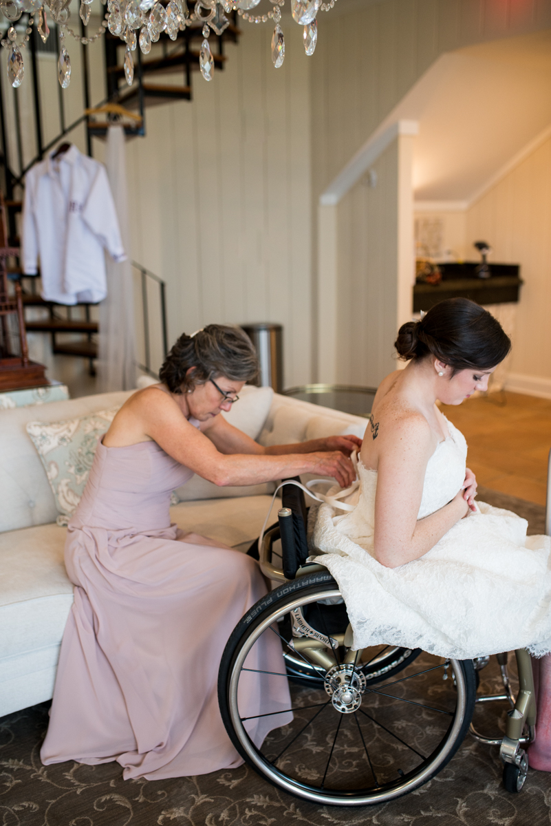 Gold and Burgundy Winter Winery Wedding | Bride in Wheelchair Getting Dressed