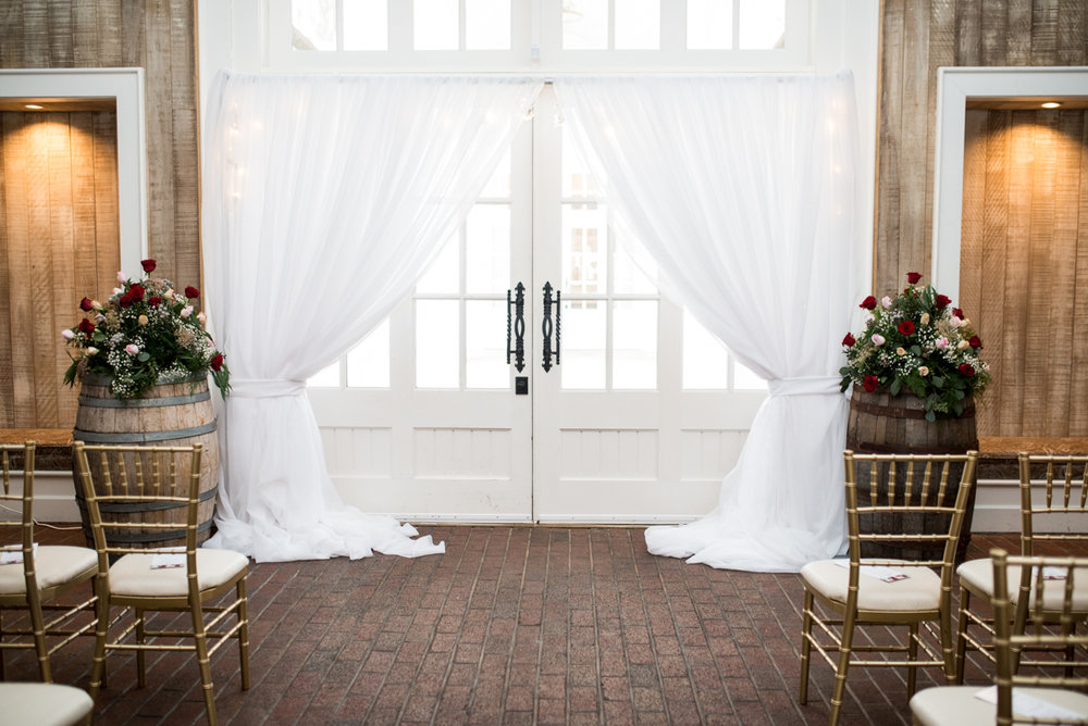 Gold and Burgundy Winter Winery Wedding | White Curtain and Barrel Wedding Ceremony