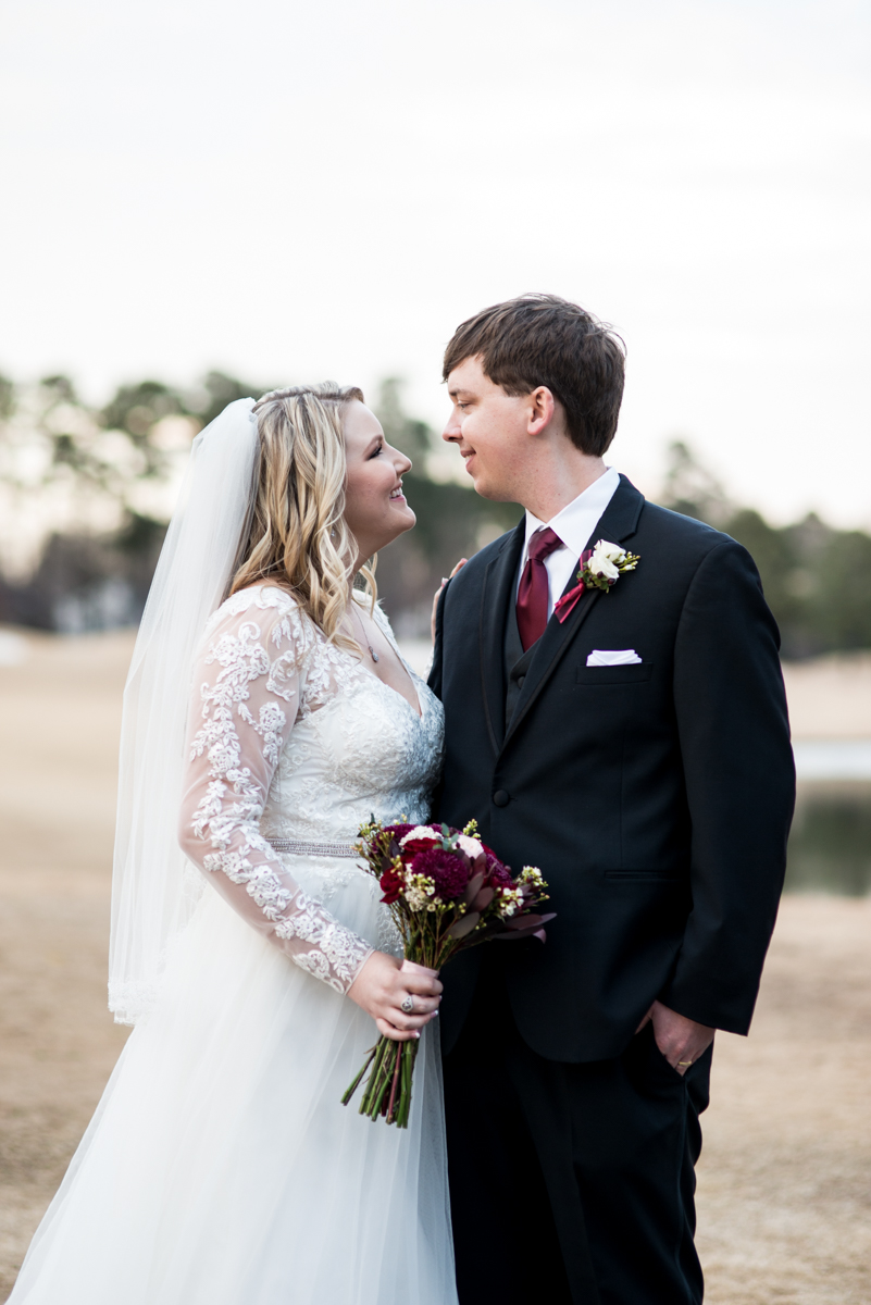 Burgundy and Blush Winter Wedding | Bride and groom portraits