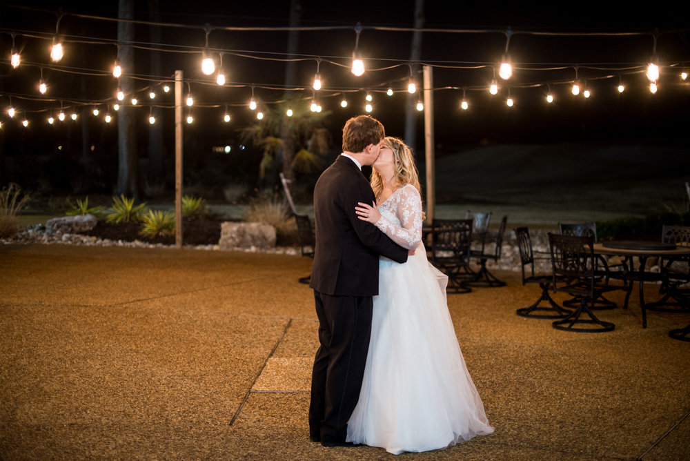 Burgundy and Blush Winter Wedding | Bride and groom under twinkle lights