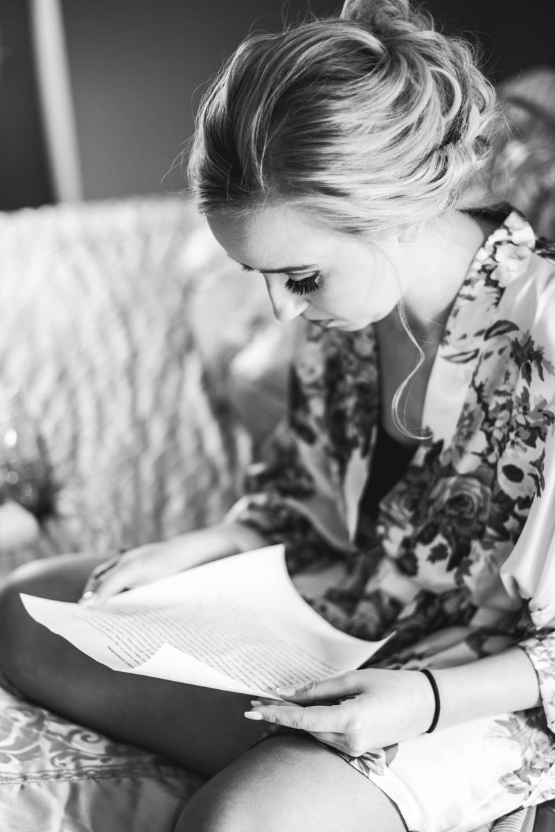 Burgundy + White Spring Wedding | Bride reading the groom's letter