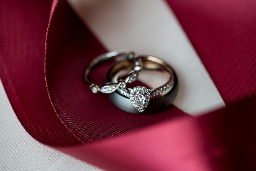 Burgundy + White Spring Wedding | Ring shot with burgundy ribbon