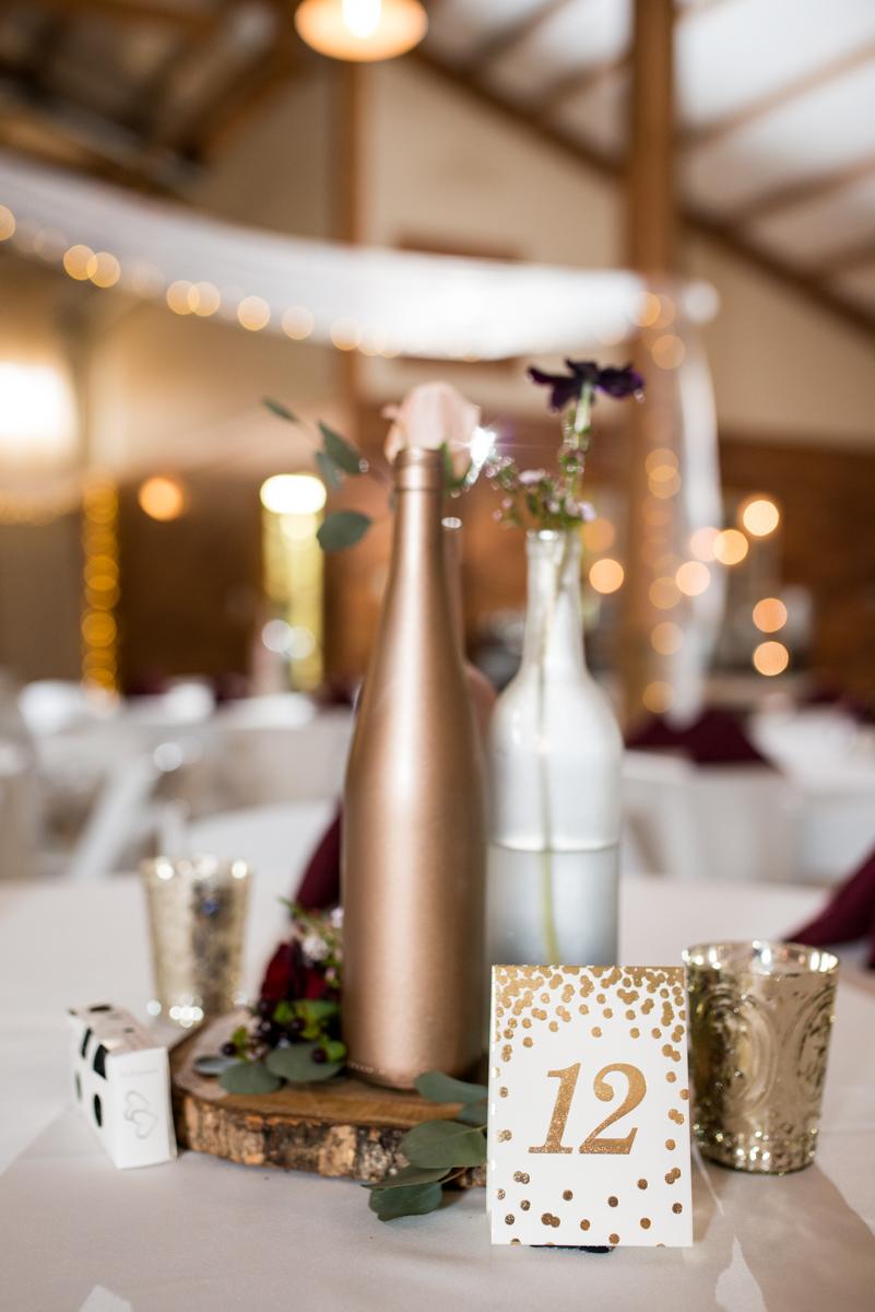 Burgundy + White Spring Wedding | Wedding reception centerpiece bottles