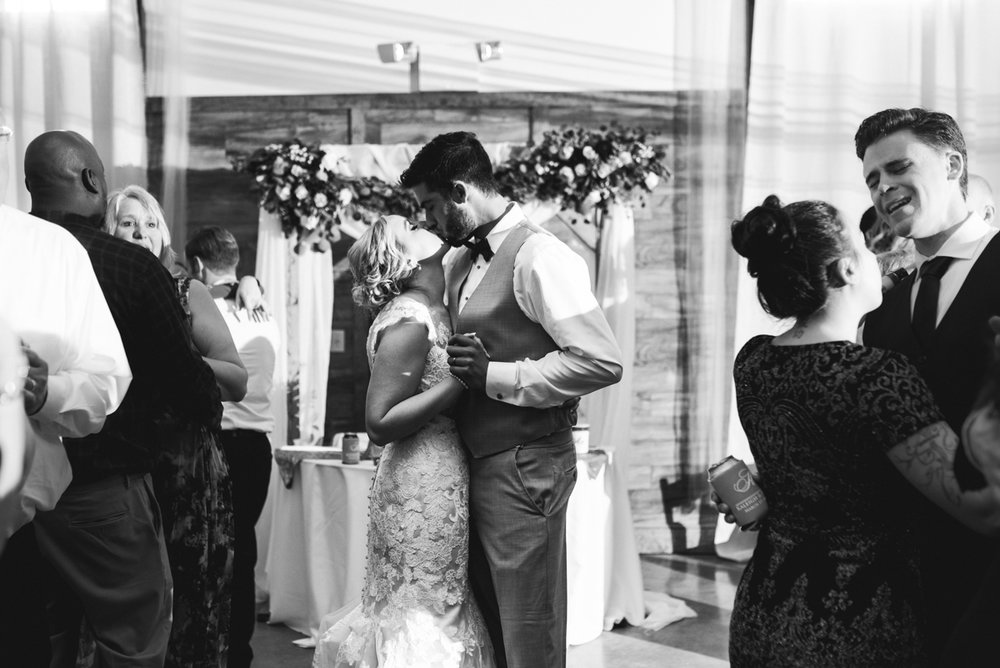 Burgundy + White Spring Wedding | Wedding reception guests dancing