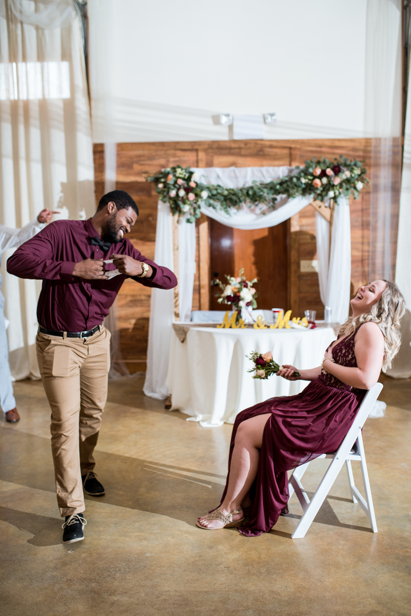 Burgundy + White Spring Wedding | Wedding reception garter toss
