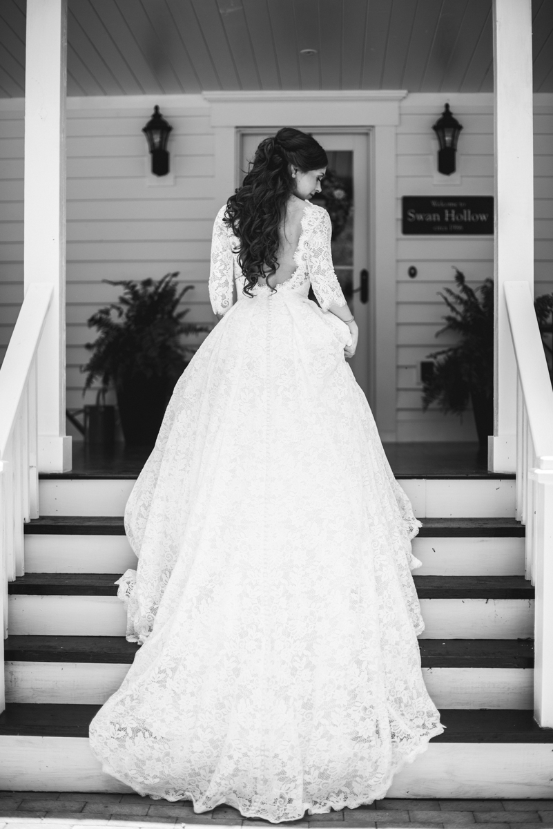 Elegant and Intimate Winery Wedding | Bride in all-over lace wedding dress with train