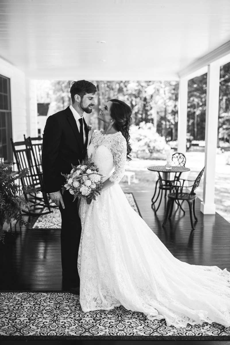 Elegant and Intimate Winery Wedding | Bride and groom portraits on front porch