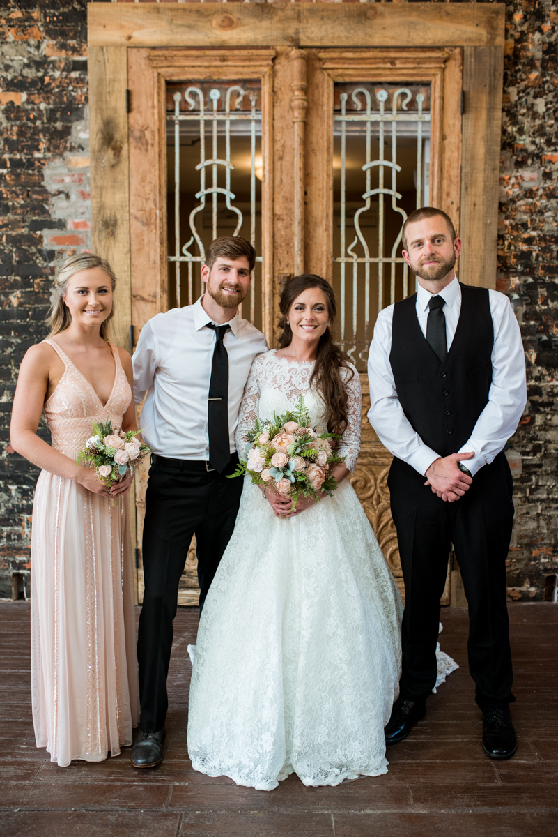 Elegant and Intimate Winery Wedding | Bridal party portraits indoors with exposed brick