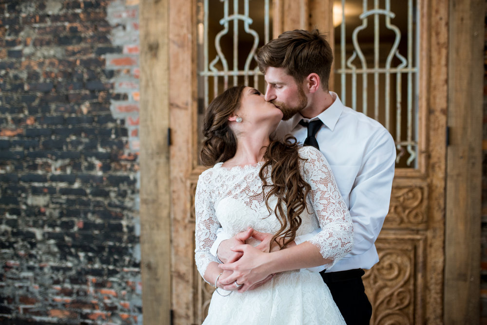Elegant and Intimate Winery Wedding | Bride and groom portraits with exposed brick