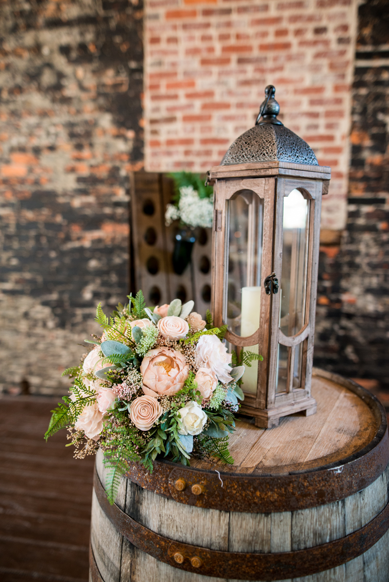 Elegant and Intimate Winery Wedding | Lantern and floral reception decorations