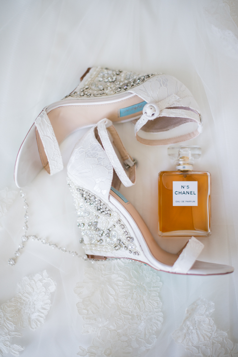 Intimate Backyard Summer Wedding on the Water | White bride's shoes with perfume