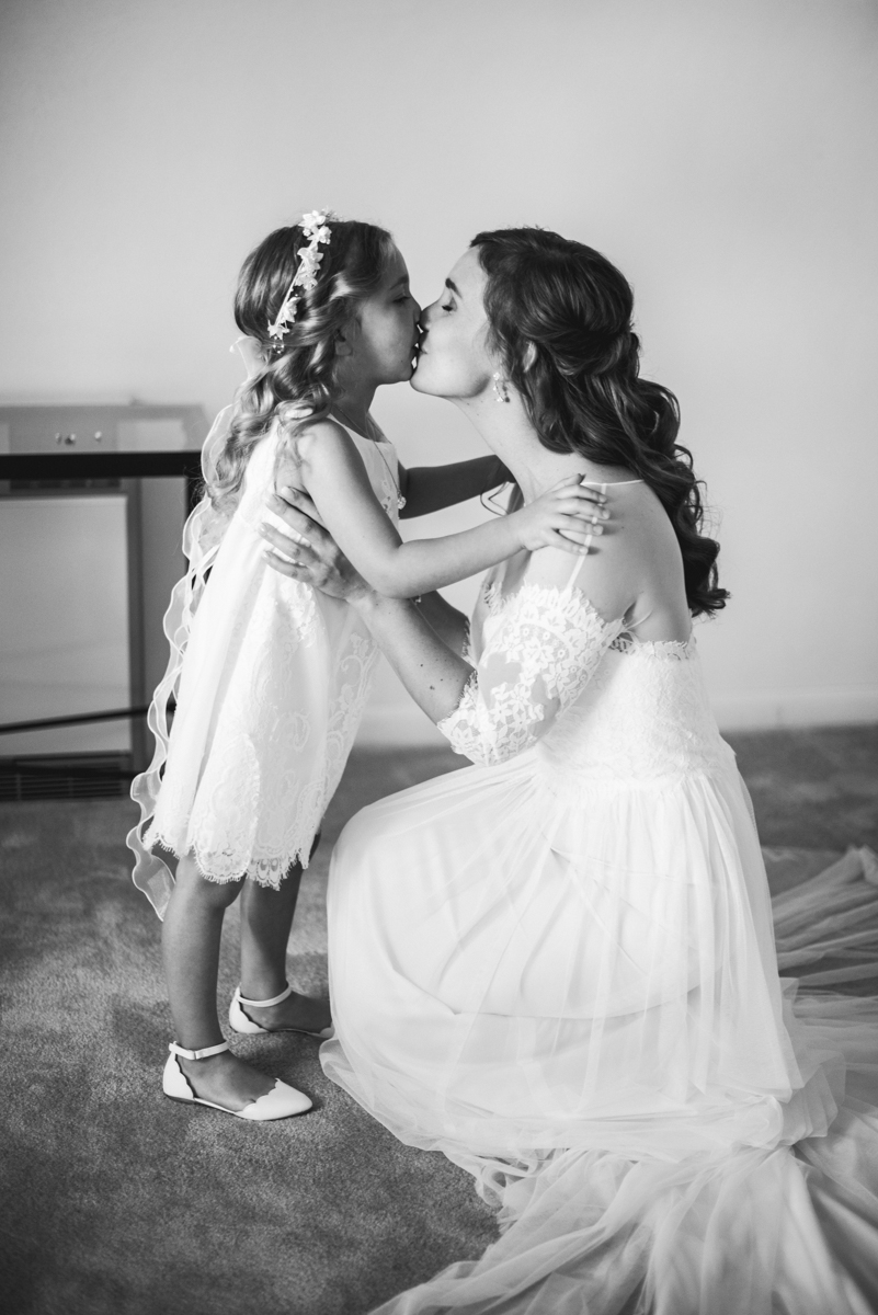 Intimate Backyard Summer Wedding on the Water | Bride with flower girl