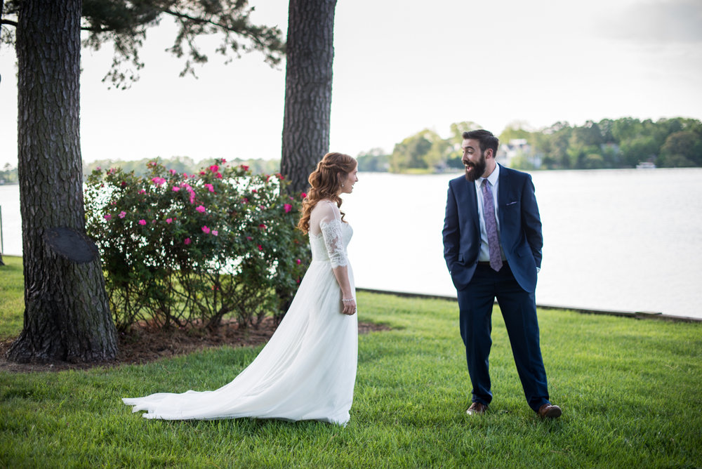 Intimate Backyard Summer Wedding on the Water | Bride and groom first look