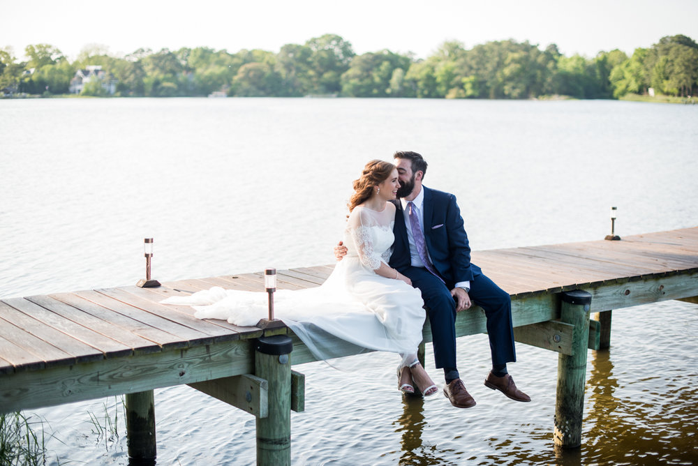 Intimate Backyard Summer Wedding on the Water | Bride and groom portraits on a dock
