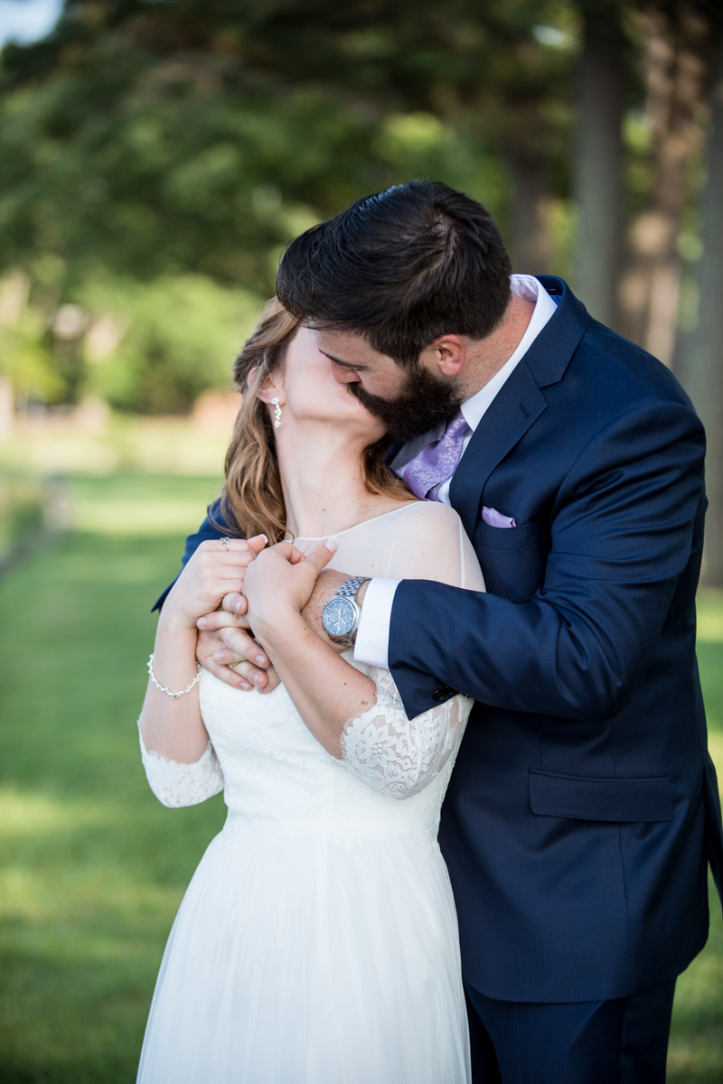 Intimate Backyard Summer Wedding on the Water | Bride and groom portraits