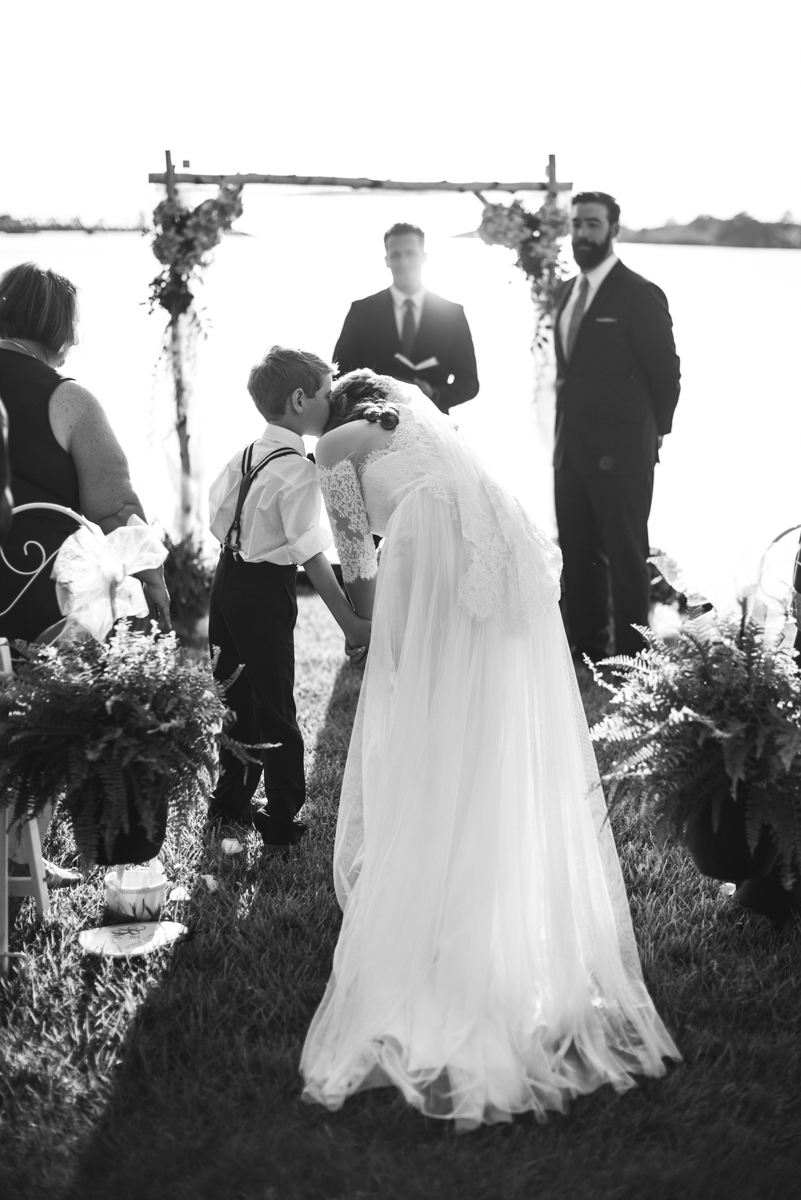 Intimate Backyard Summer Wedding on the Water | Son walking mom down the aisle