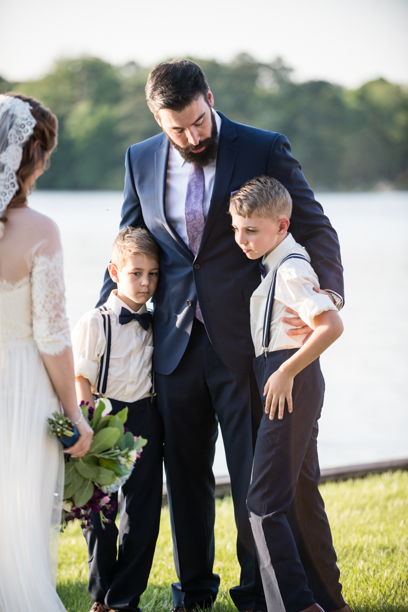 Intimate Backyard Summer Wedding on the Water | Father with sons at altar