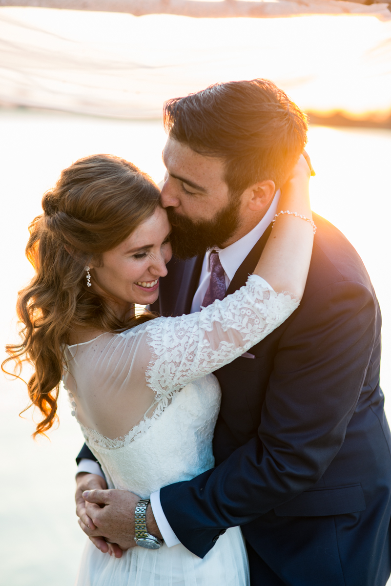 Intimate Backyard Summer Wedding on the Water | Sunset bride and groom portraits