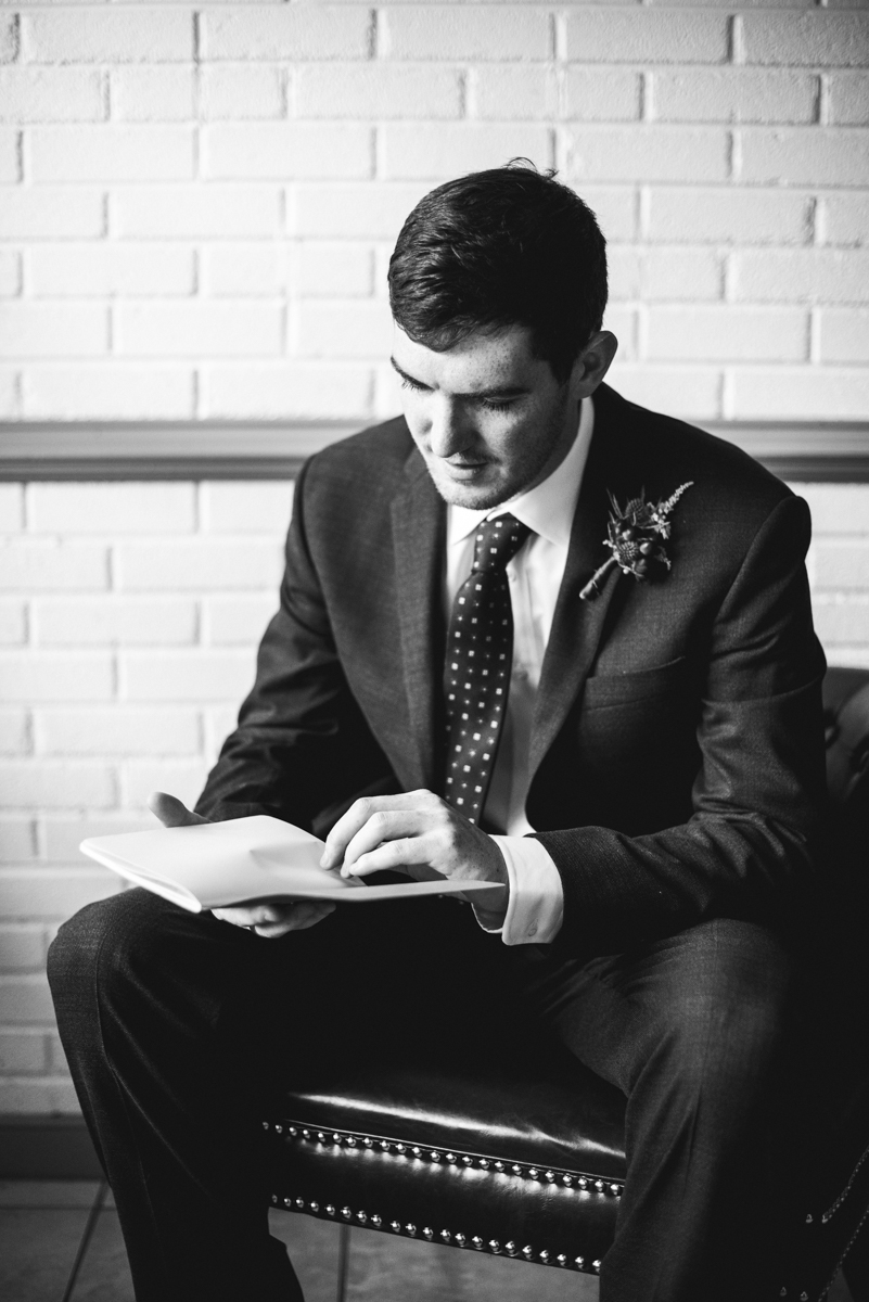 James Monroe Highland Wedding in Charlottesville | Groom reading letter