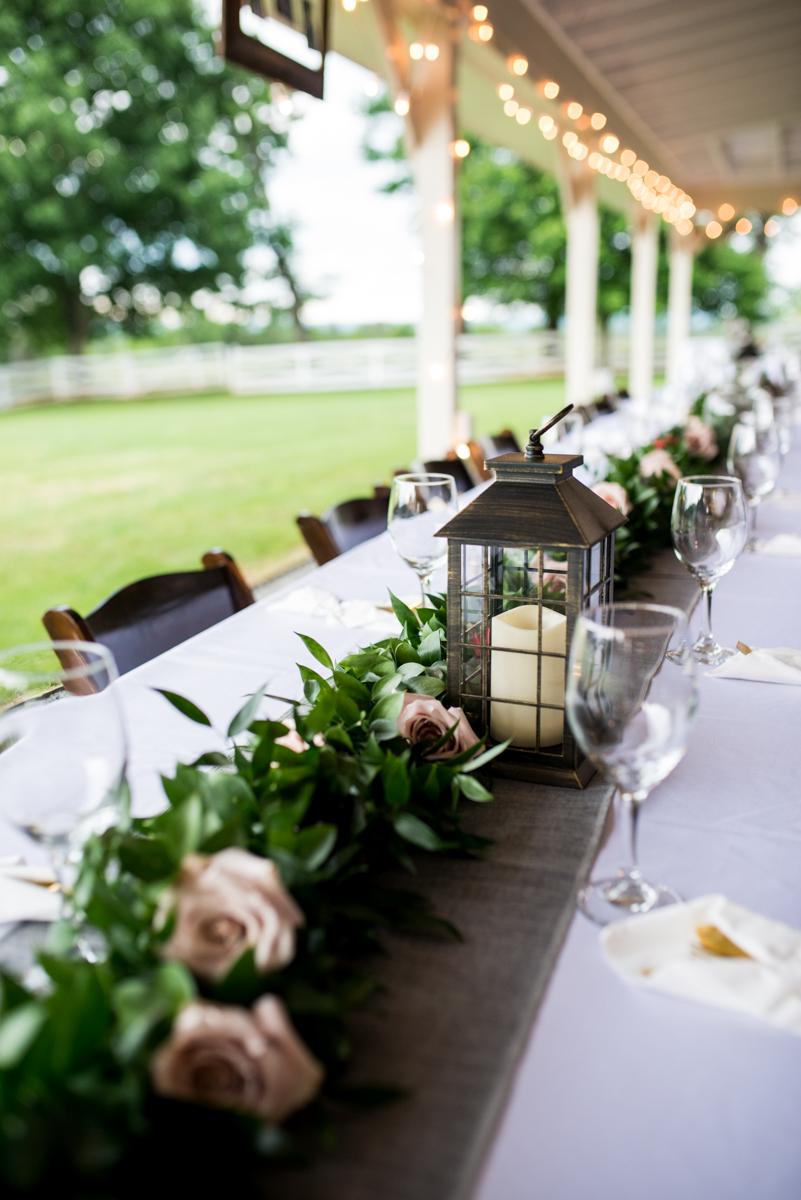 James Monroe Highland Wedding in Charlottesville | Lantern with greenery centerpiece