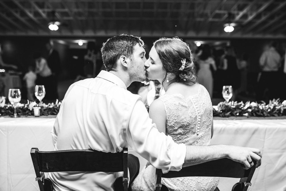 James Monroe Highland Wedding in Charlottesville | Bride and groom reception kiss