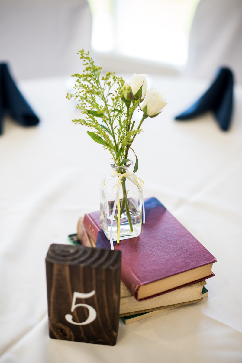 Yellow, Navy, and White Summer Wedding | Vintage book and bud vase centerpiece