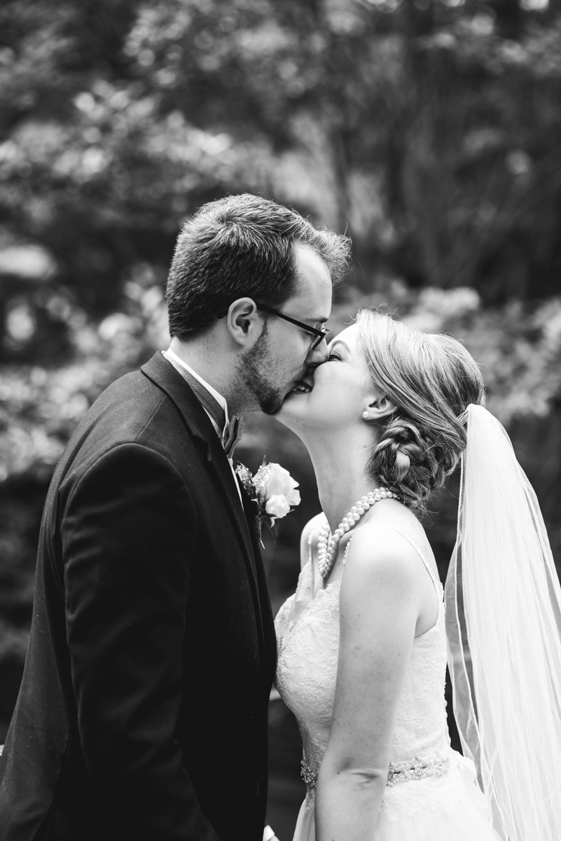 Yellow, White, and Navy Summer Wedding | Bride and groom portraits