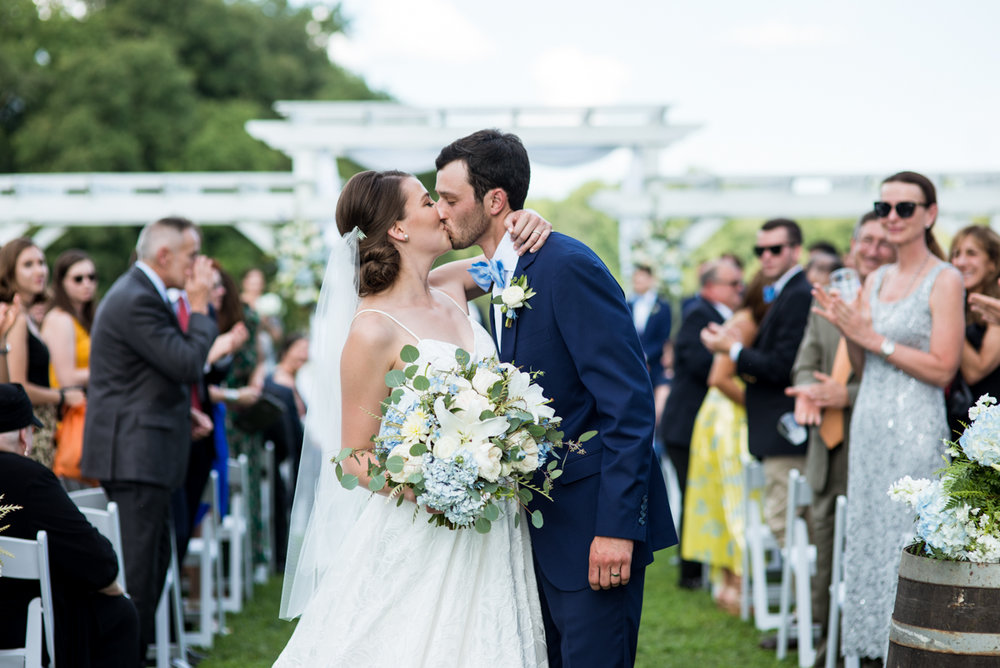 Navy and White Summer Wedding | Bride and groom kiss