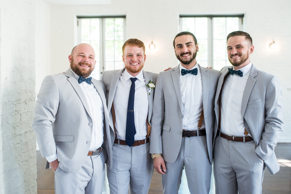 Minimalist White and Green Summer Wedding | Gray Groomsmen Suits with Navy Bowtie