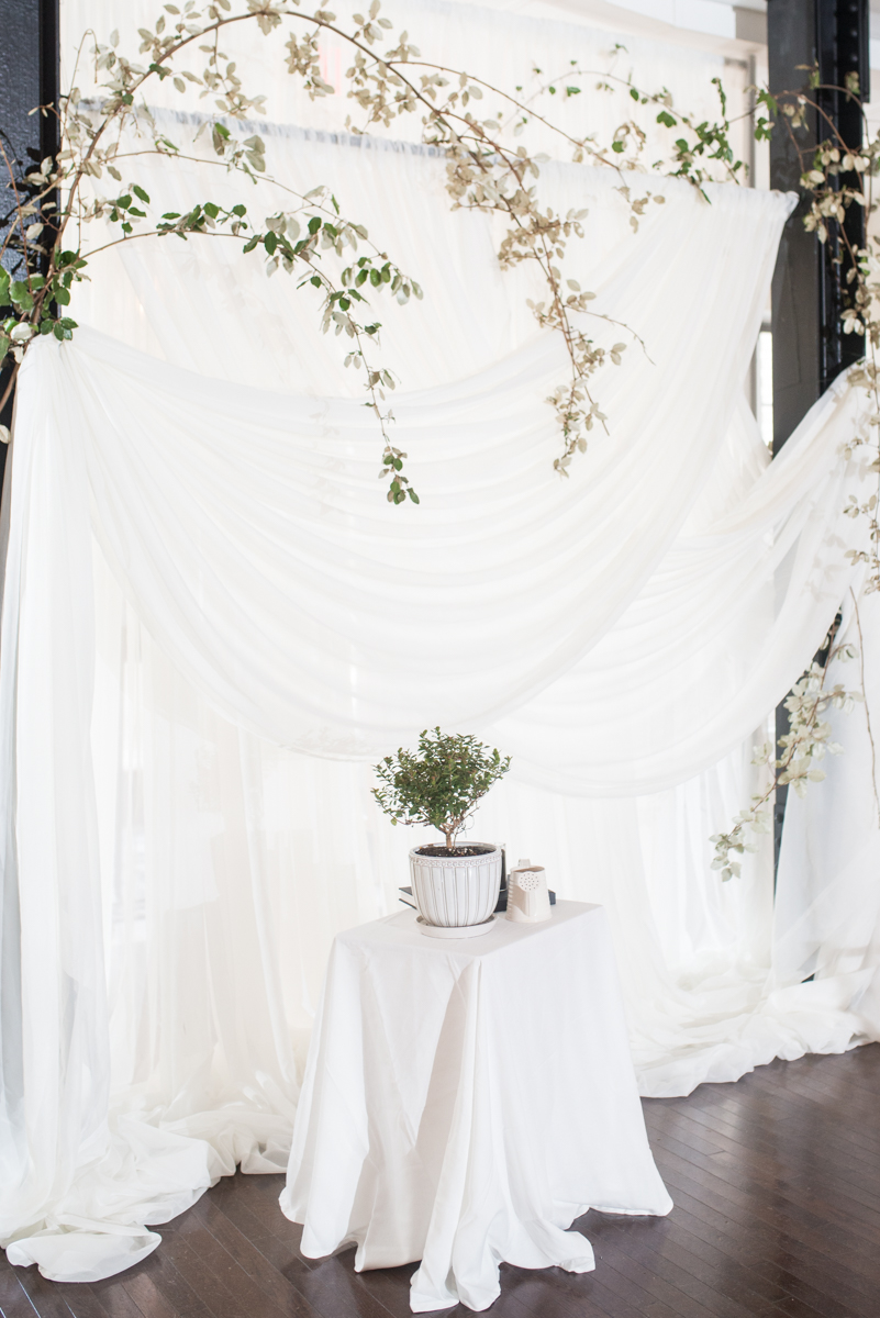 Minimalist White and Green Summer Wedding | White Draped Wedding Ceremony Wall
