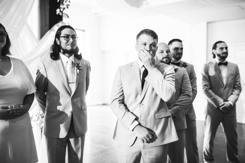 Minimalist White and Green Summer Wedding | Groom reacts to seeing bride