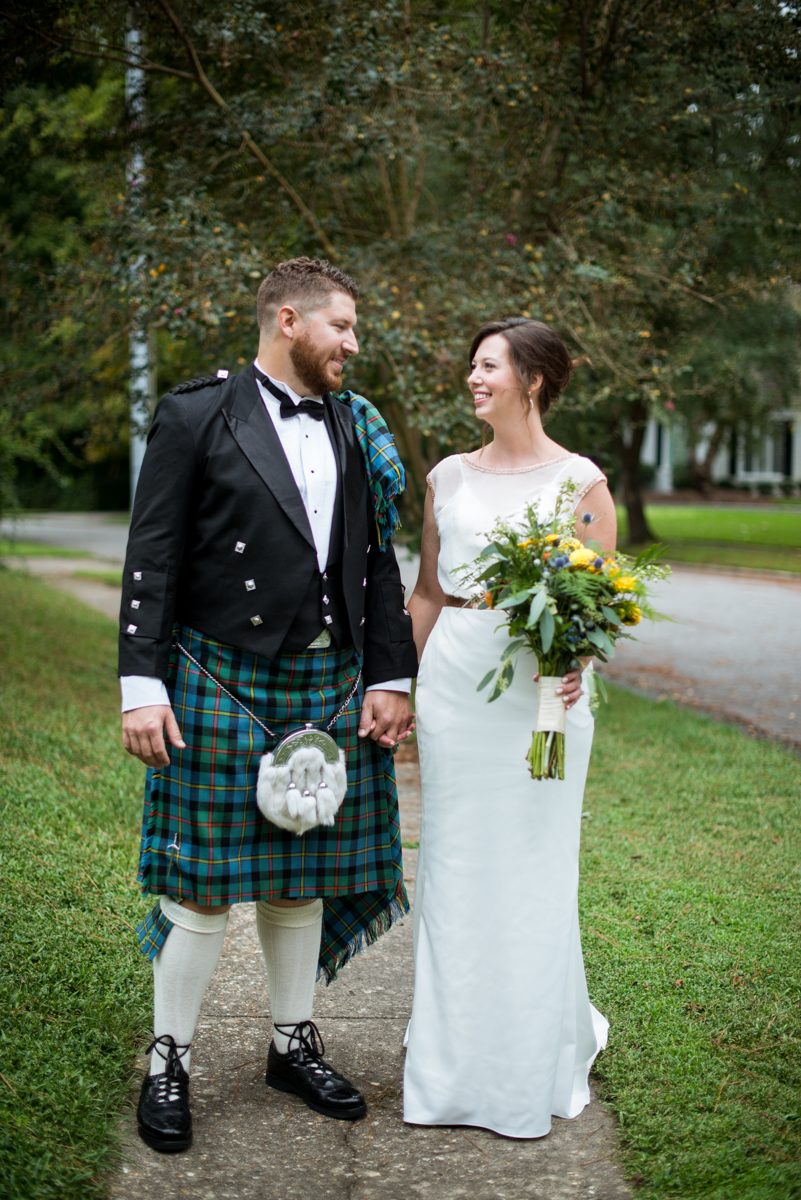 Scottish Themed Wedding with Burgundy and Copper | Bride and Groom First Look with Kilt