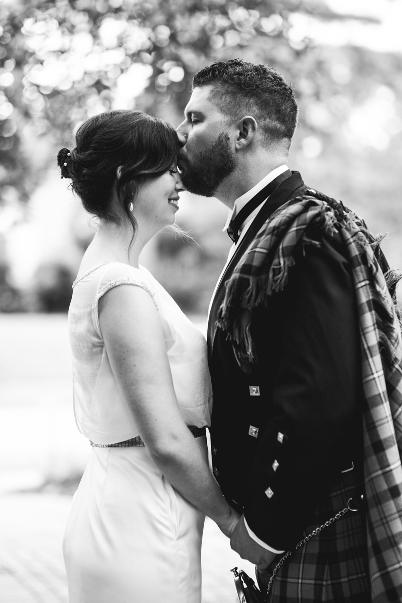 Scottish Themed Wedding with Burgundy and Copper   Bride and Groom First Look with Kilt